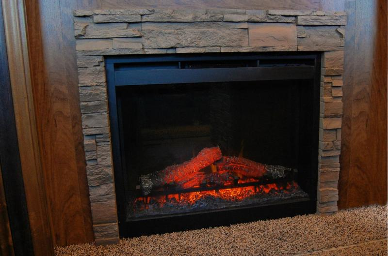 Living Room Fireplace with Rock Surround